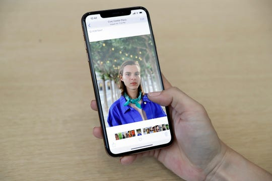 A photograph is displayed on a iPhone XS Max during an event to announce new products at Apple Headquarters Wednesday, Sept. 12, 2018, in Cupertino, Calif.