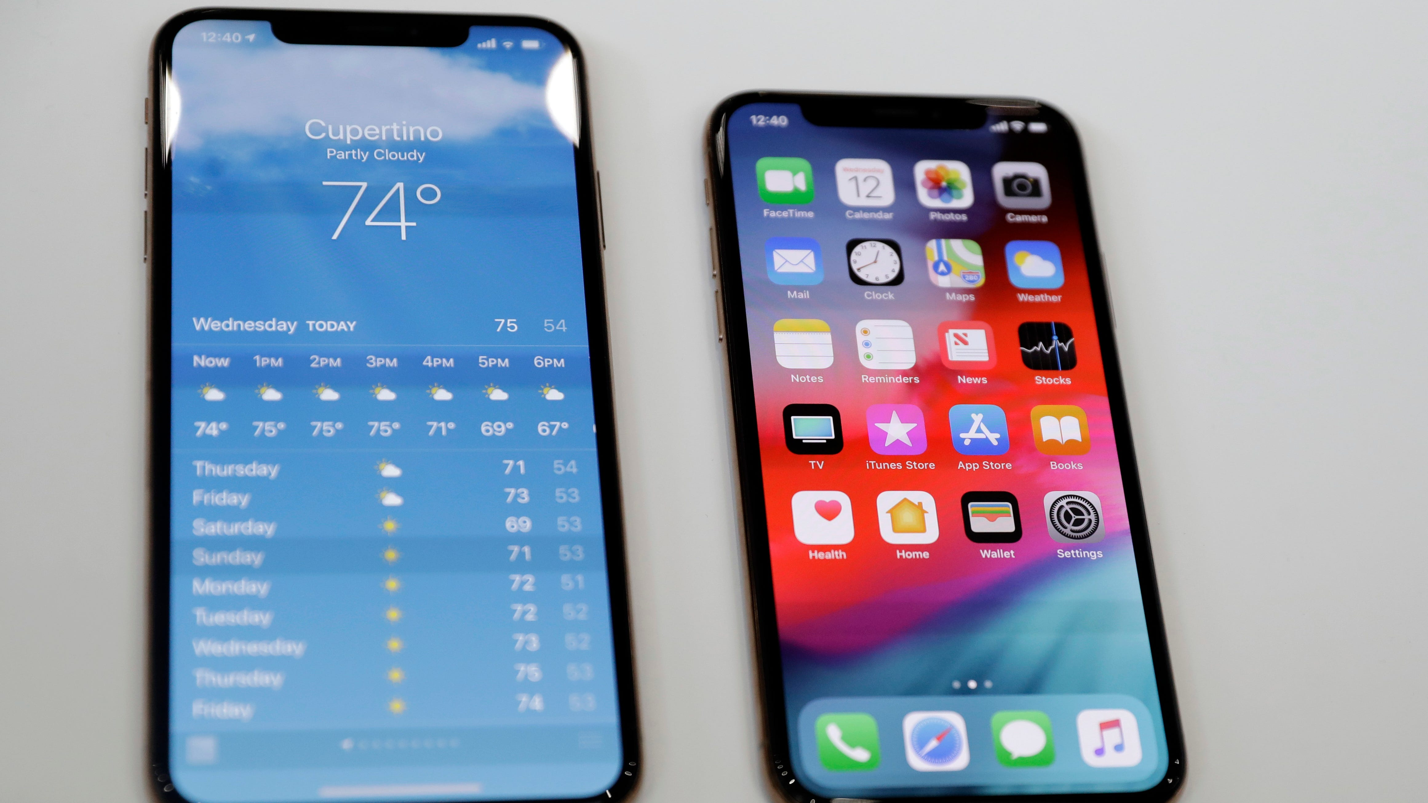The iPhone XS, right, and XS Max are displayed side to side during an event to announce new products at Apple headquarters Wednesday, Sept. 12, 2018, in Cupertino, Calif.