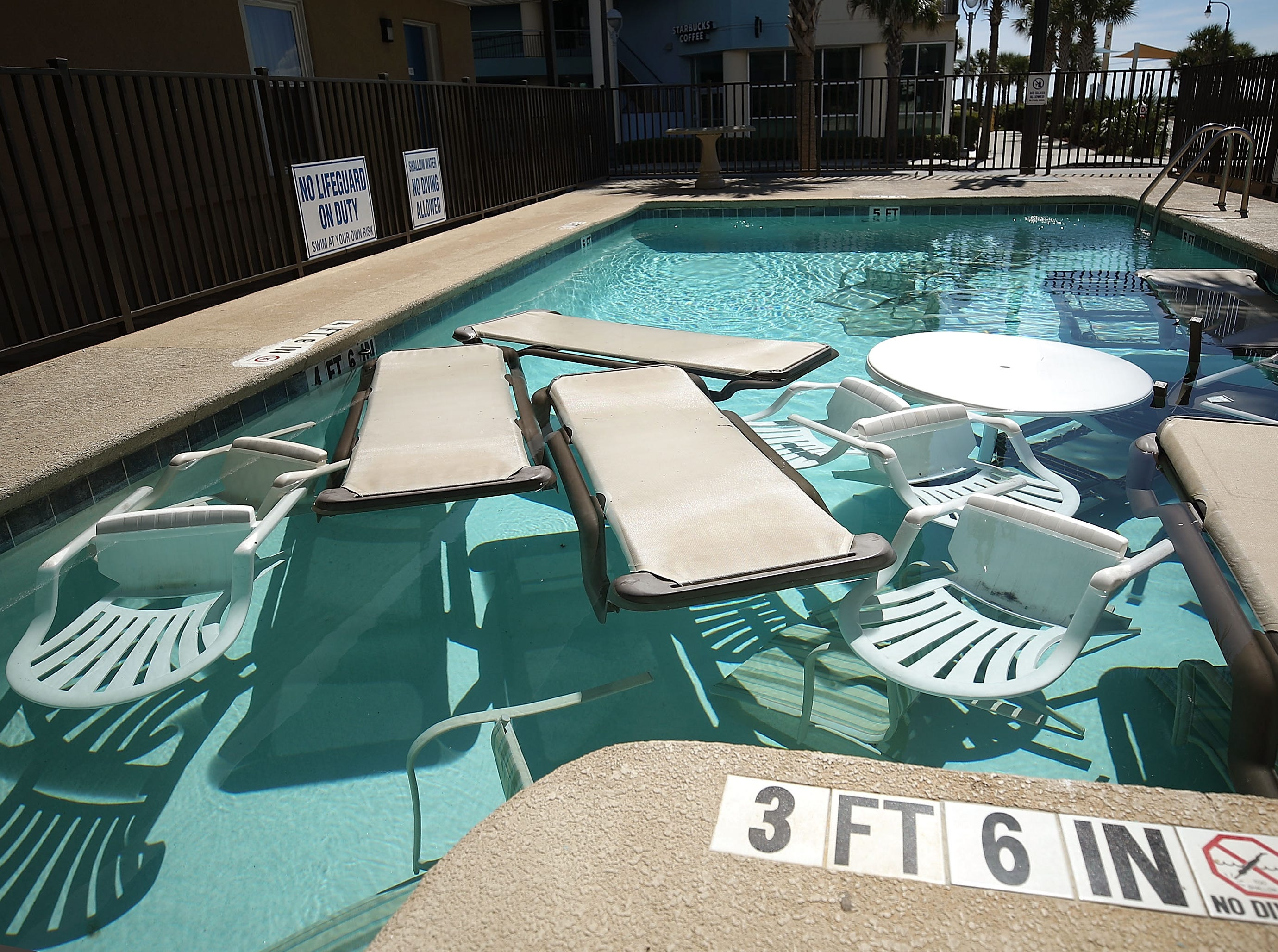 MRYTLE BEACH, SC. SEPTEMBER 12: Poolside furniture is placed in the pool of a hotel ahead of the approaching Hurricane Florence on September 12, 2018 in Mrytle Beach, South Carolina. Hurricane Florence is expected on Friday possibly as a category 4 storm along the Virginia, North Carolina and South Carolina coastline.