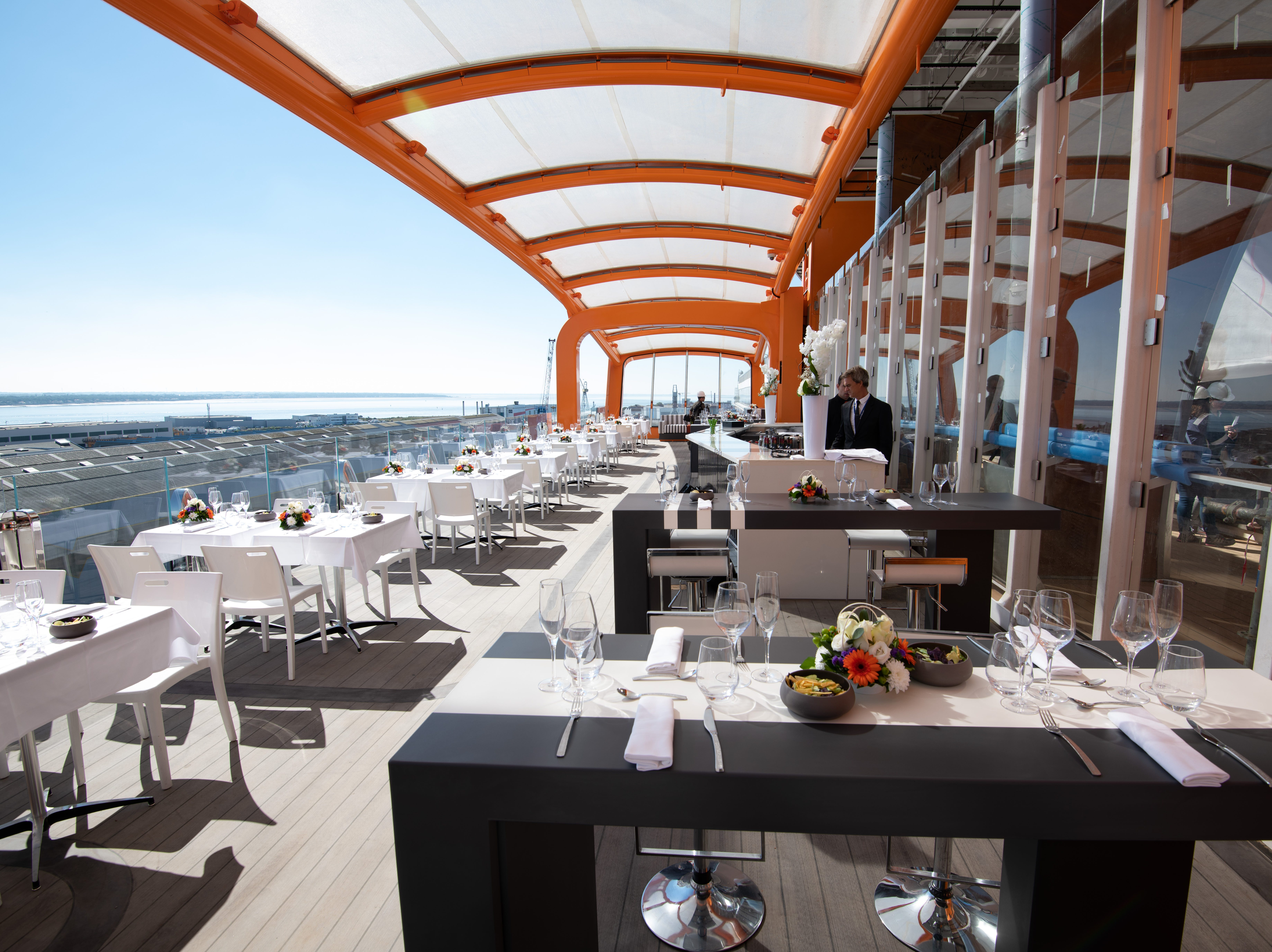 The Magic Carpet platform on Celebrity Edge also can serve as an extension of the ship's main pool area when placed alongside Deck 14. The platform features space that can be used for live musical performances.