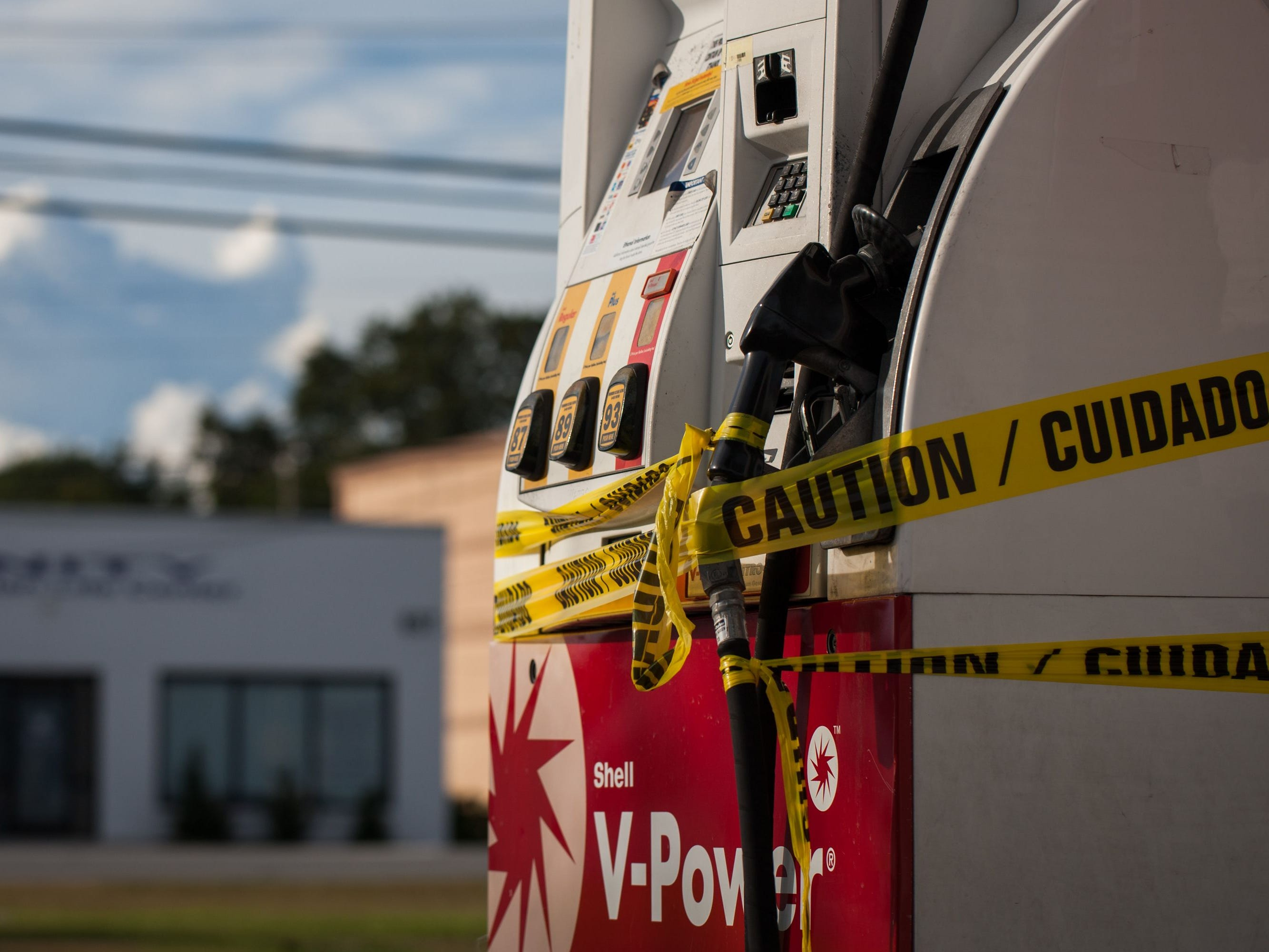 A gas station sits empty with its fuel pumps wrapped in caution tape in Jacksonville, N.C., on Sept. 12, 2018, in advance of Hurricane Florence.