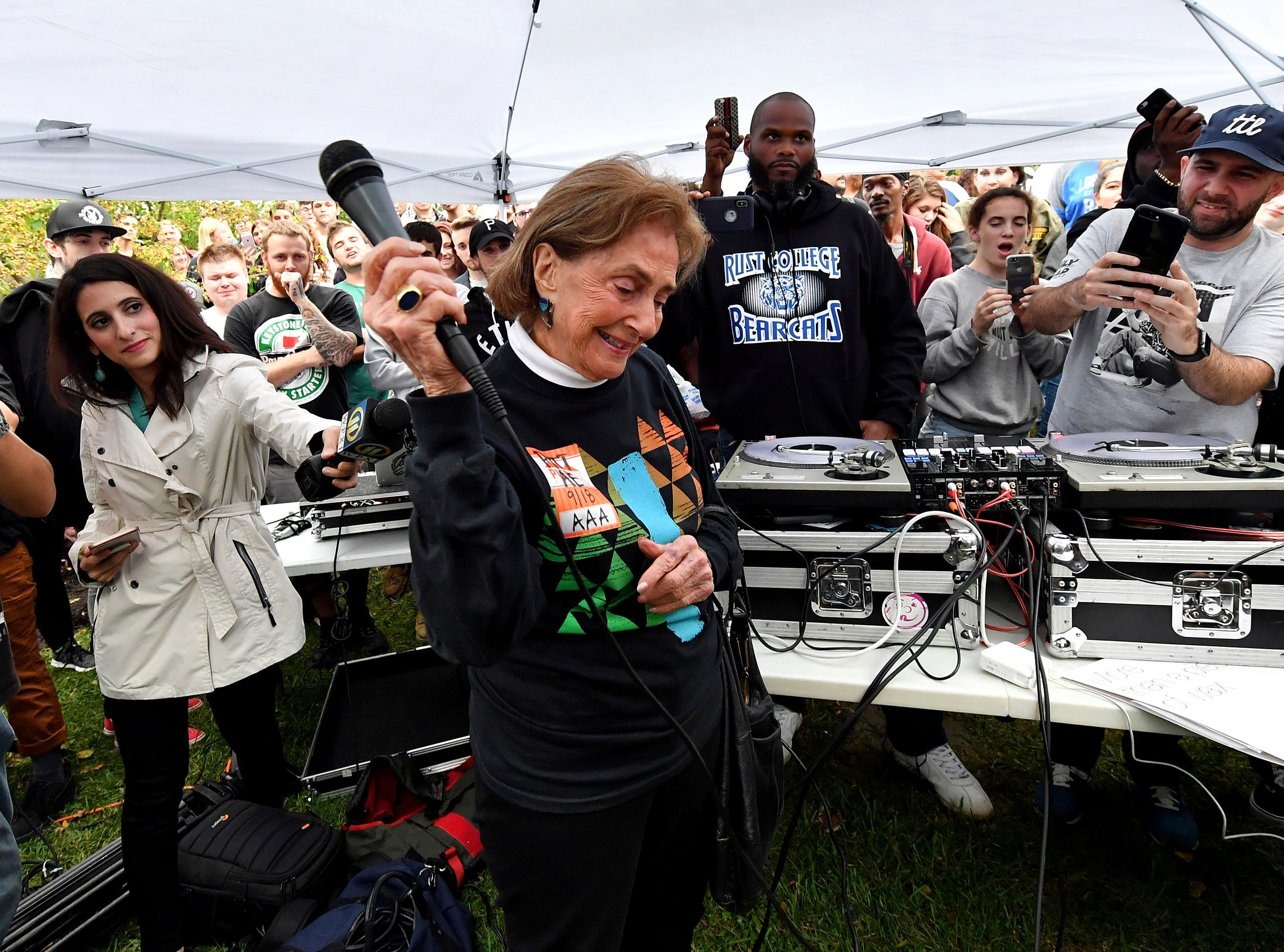 "Marcia Weiss, grandmother of rapper Mac Miller, pauses as the crowd cheers for her during a vigil for the rapper Tuesday, Sept. 11, 2018 at Blue Slide Park in Pittsburgh, Pa. His debut studio album was named ""Blue Slide Park."" (Matt Freed/Post-Gazette via AP) ORG XMIT: PAPIT102"