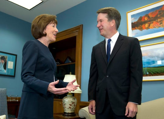 In this Tuesday, Aug. 21, 2018, file photo, Sen. Susan Collins, R-Maine, speaks with Supreme Court nominee Judge Brett Kavanaugh at her office, before a private meeting on Capitol Hill in Washington. Collins has been targeted by Democrats hoping that the centrist Republican will vote against the judge's nomination.