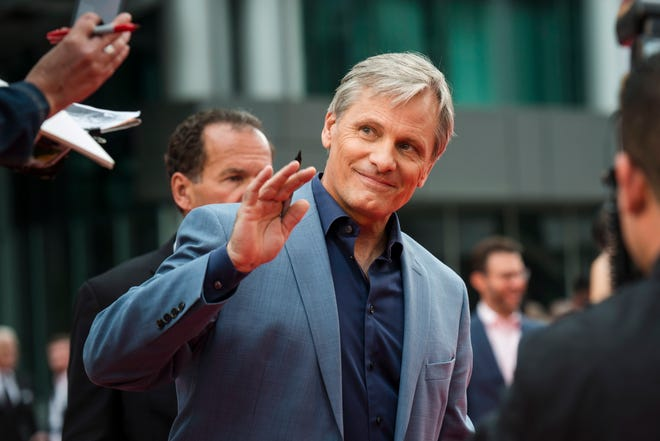 "Actor Viggo Mortensen waves to fans as he arrives ahead of the screening of ""Green Book"" during the Toronto International Film Festival in Toronto, on Tuesday, Sept. 11, 2018. (Christopher Katsarov/The Canadian Press via AP) ORG XMIT: CKL102"