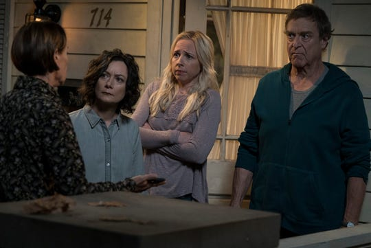 Family members (Laurie Metcalf, left, Sara Gilbert, Lecy Goranson and John Goodman) learn how matriarch Roseanne Conner died in the series premiere of 'The Conners,' a 'Roseanne' spinoff put together quickly after the firing of Roseanne Barr and cancellation of the iconic comedy in May.
