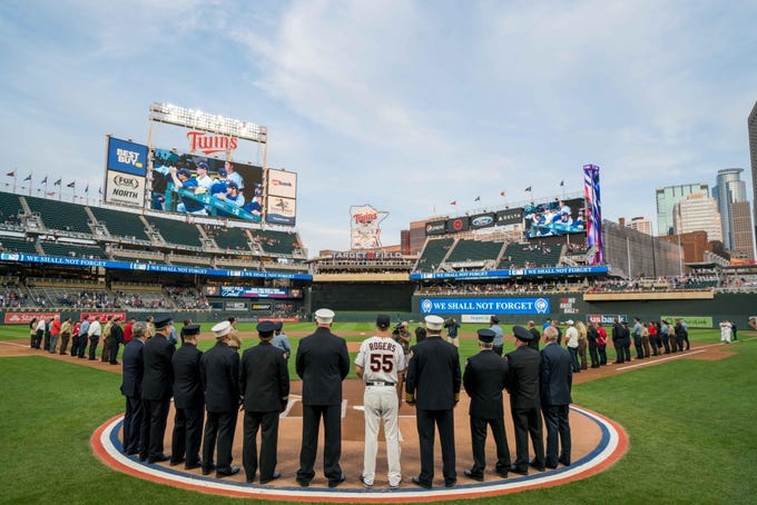 Minnesota Twins relief pitcher Taylor Rogers joins first responders in a 9/11 tribute before the game against the New York Yankees at Target Field.