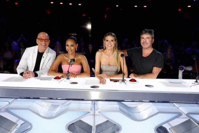 """""""America's Got Talent"""" judges Howie Mandel, left, Mel B, Heidi Klum and Simon Cowell pose during Tuesday's live semifinals performance show."""