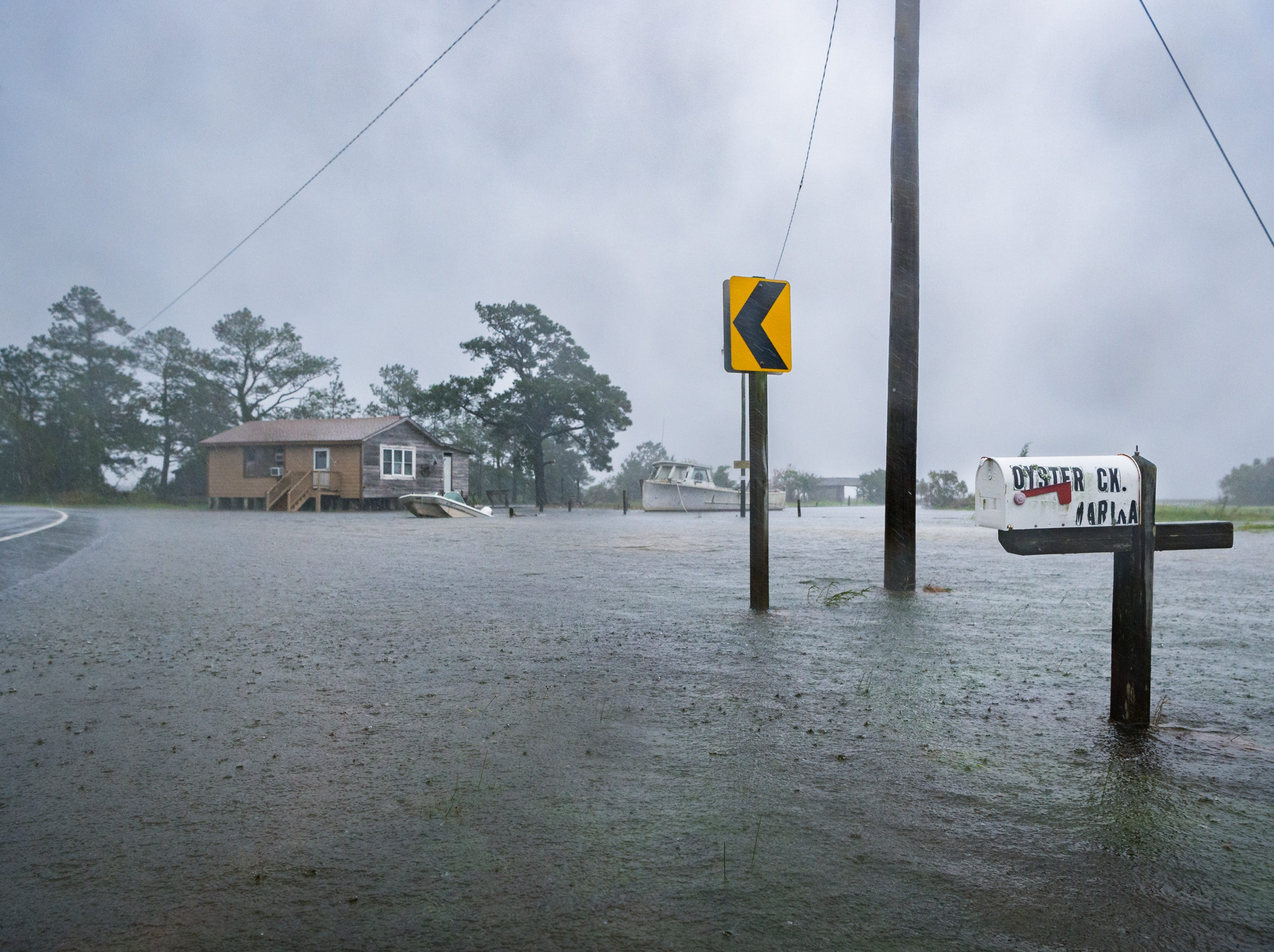 A mailbox on Oyster Creek Street in Swan Quarter, N.C sits partially submerged as heavy rain and wind increases with Hurricane Florence moving closer to the coastline Sept. 13, 2018.