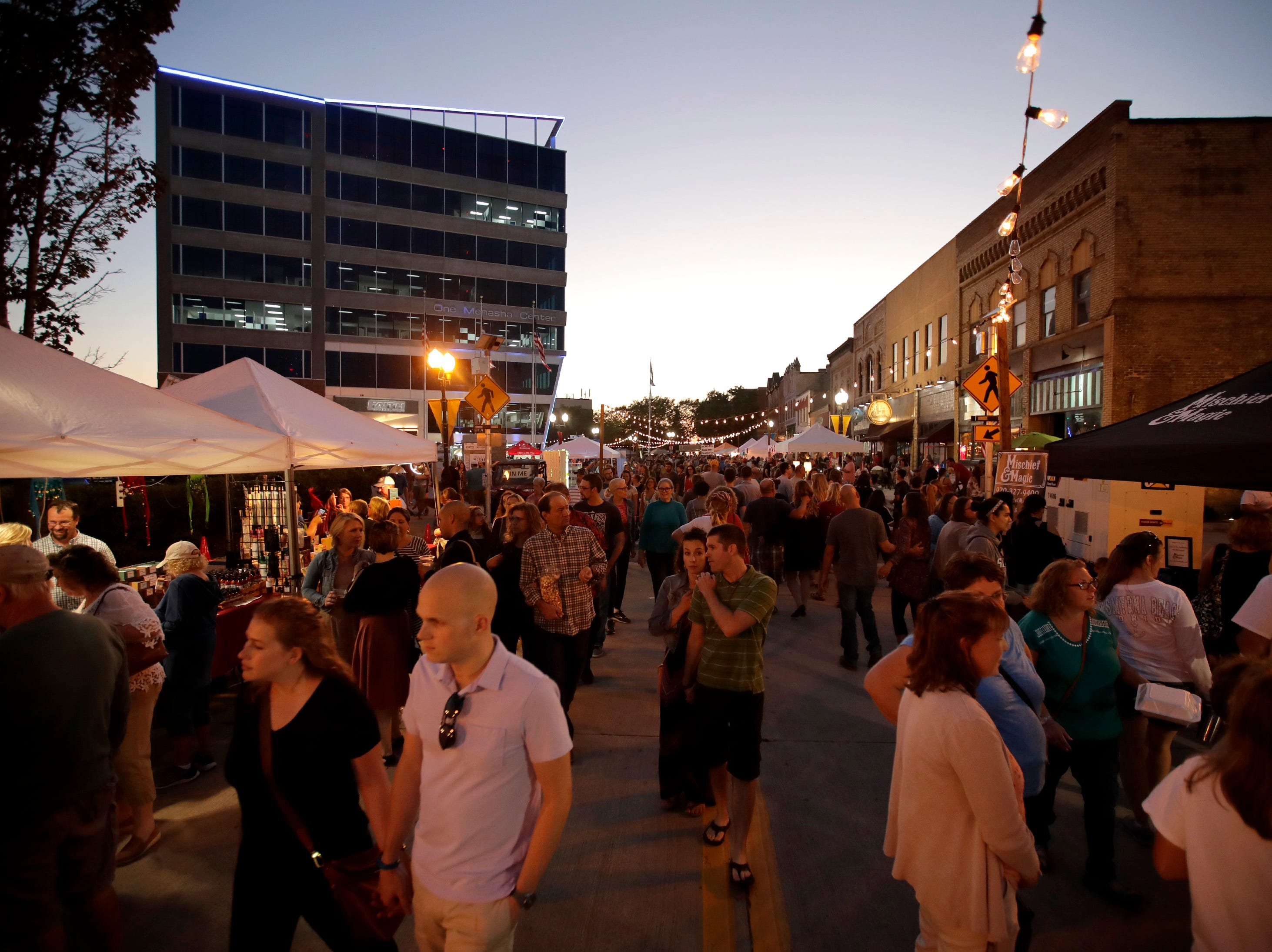 The crowd moves down Main Street during Bazaar After Dark Wednesday, Sept. 12, 2018, in Menasha, Wis.Danny Damiani/USA TODAY NETWORK-Wisconsin