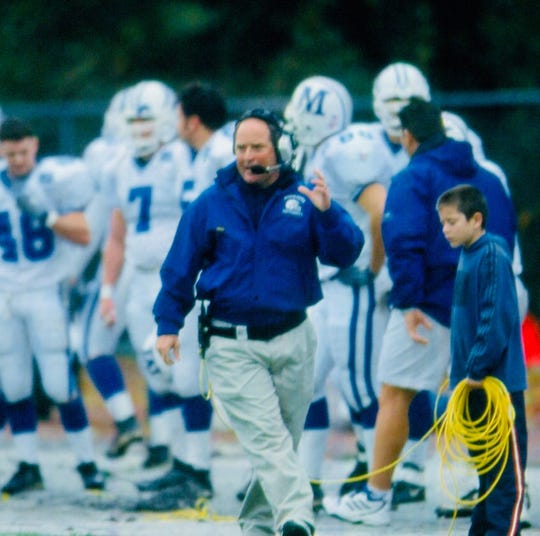 Monmouth caoch Kevin Callahan stalks the sideline while his son, Kevin Jr., stands nearby.  Kevin Callahan Jr. is now an assistant coach at Lafayette, which hosts his father's team on Saturday in Easton, Pa.