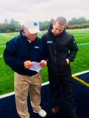 Monmouth head coach Kevin Callahan Sr. (left) talks to his son, Kevin Jr., then working as an assistant at Columbia.