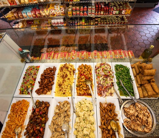 The display case with freshly made dishes gives way to the grocery  section where shelves are stocked with Italian specialty items at Angelo's Italian Market, Little Silver.
