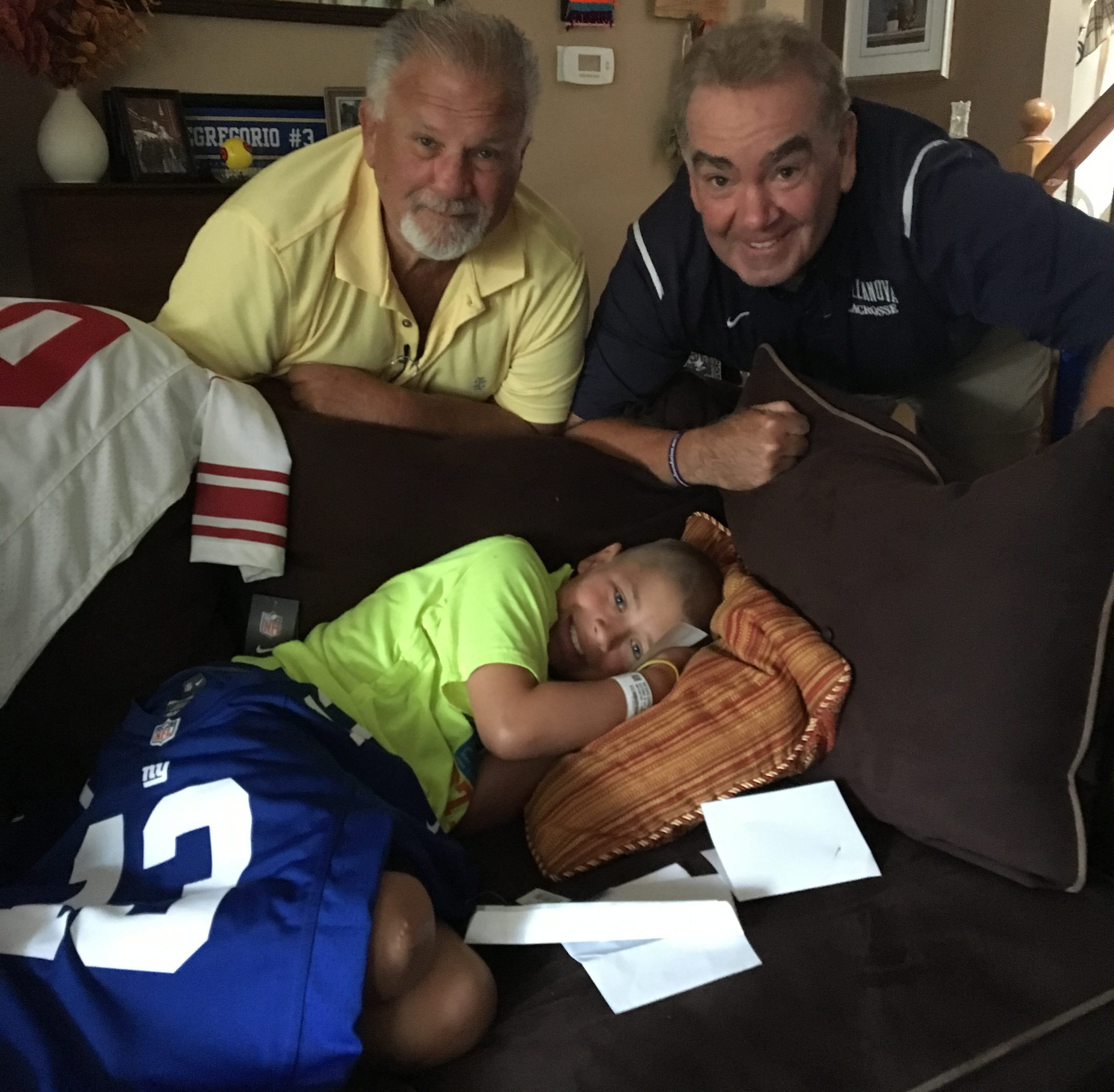 Frances Foundation officials Rocco Flammia and Bob Heugle deliver an Odell Beckham jersey and Giants  tickets to Will DeGregorio.