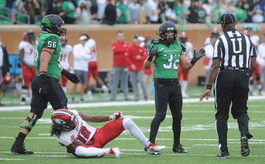North Texas receiver Michael Lawrence (32) states his case to an official after getting into an altercation blocking Incarnate Word defender Louis Otis (10). No penalty was called on the play, and North Texas beat the Cardinals 58-16 on Saturday, Sept. 8, 2018 at Apogee Stadium in Denton.