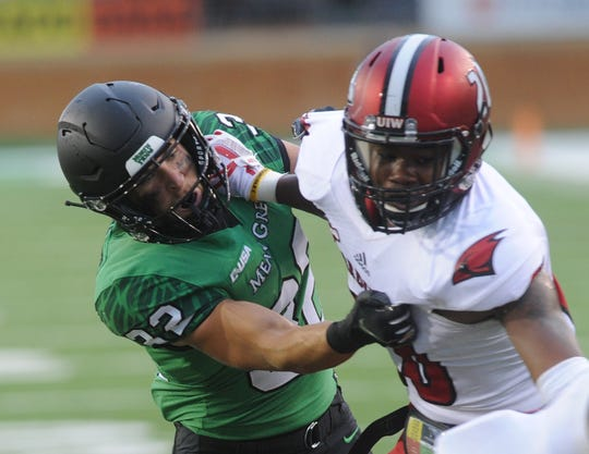 North Texas receiver Michael Lawrence, left, tries to block Incarnate Word safety Ian Peterson after a catch by Rico Bussey in the first half. The Mean Green beat Incarnate Word 58-16 on Saturday, Sept. 8, 2018 at Apogee Stadium in Denton.