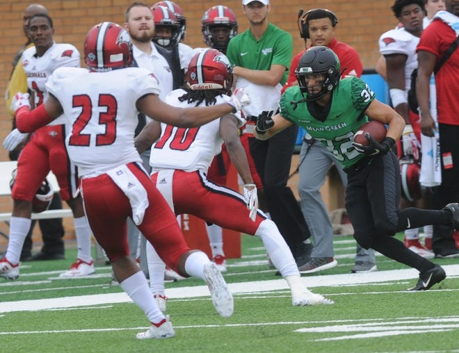 North Texas receiver Michael Lawrence, right, looks for running room after making a catch against Incarnate Word. The play went for 26 yards down to the Cards' 31-yard line. North Texas won the game 58-16 on Saturday, Sept. 8, 2018 at Apogee Stadium in Denton.