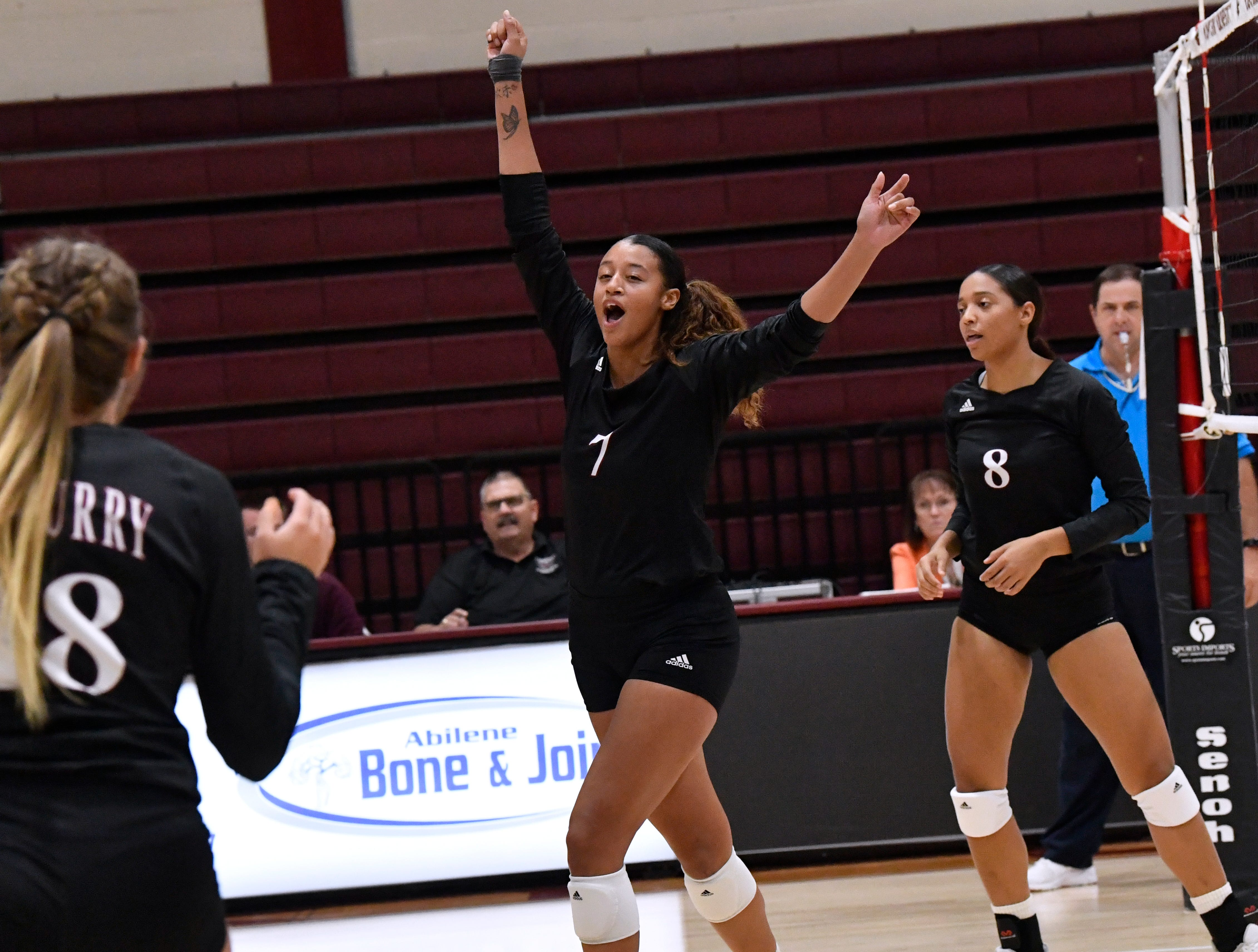 McMurry middle blocker Kianni Mitchell celebrates a successful block during Wednesday's game against Schreiner University.