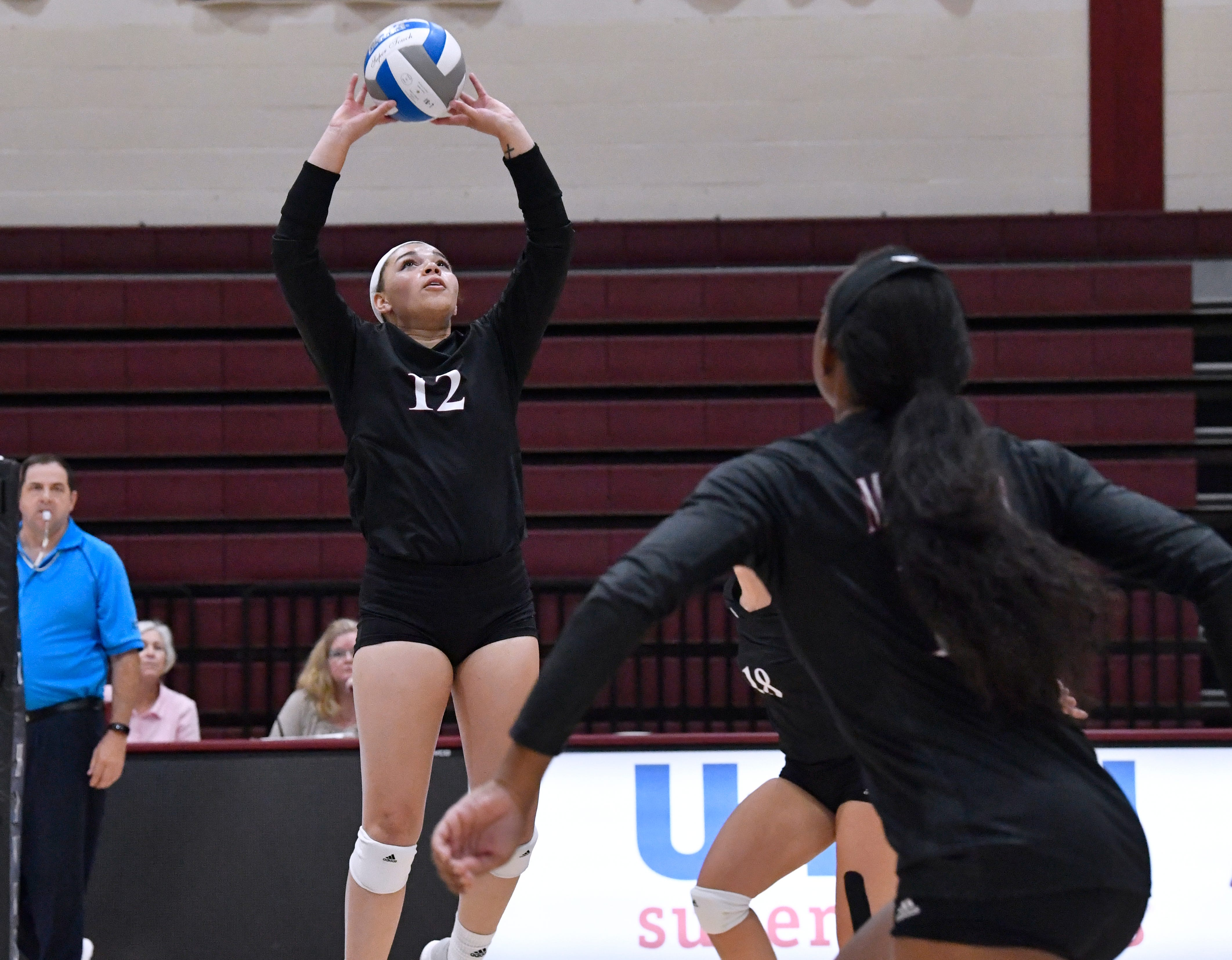 Emarie James sets the ball for McMurry University during the War Hawks' volleyball game against Schreiner University on Wednesday. McMurry won, 25-10, 25-15, 25-17.