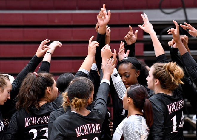 McMurry University volleyball players come together before Wednesday's game against Schreiner University Sept. 12, 2018. McMurry won, 25-10, 25-15, 15-17.