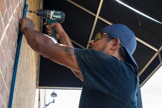 Business is booming: Though Chef & the Farmer is closed until Hurricane Florence passes, the men who worked Wednesday to cover the restaurant's doors and windows with plywood are seeing plenty of business. The Kinston restaurant was one of several businesses that they've boarded shut in the past several days, they said.