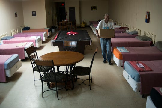 Empty for now: Friends of the Homeless Emergency Shelter, in downtown Kinston, stood empty Wednesday afternoon as Cleoxin Waters restocked supplies. But come Thursday, when Hurricane Florence hits, Jasper Newborn, who founded the shelter in 1990, hopes that the city's homeless population fills his shelter's beds.