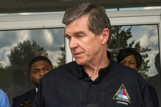 Get out: At three separate press conferences Wednesday, North Carolina Gov. Roy Cooper warned anybody who would listen to evacuate if they're in Hurricane Florence's path.