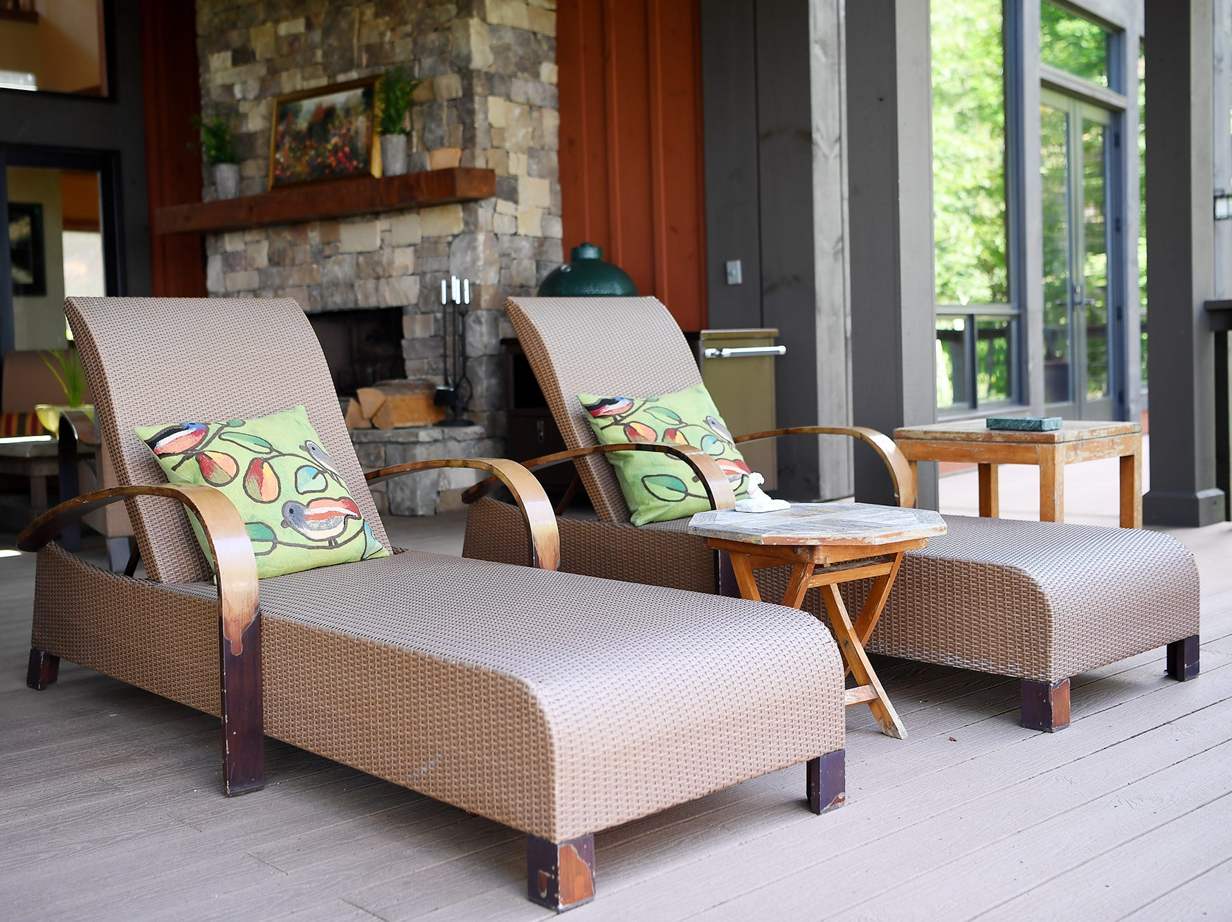 Lounge chairs face a view of the mountains in Jim and Sabrina Watson's Balsam Mountain Preserve home in Jackson County.