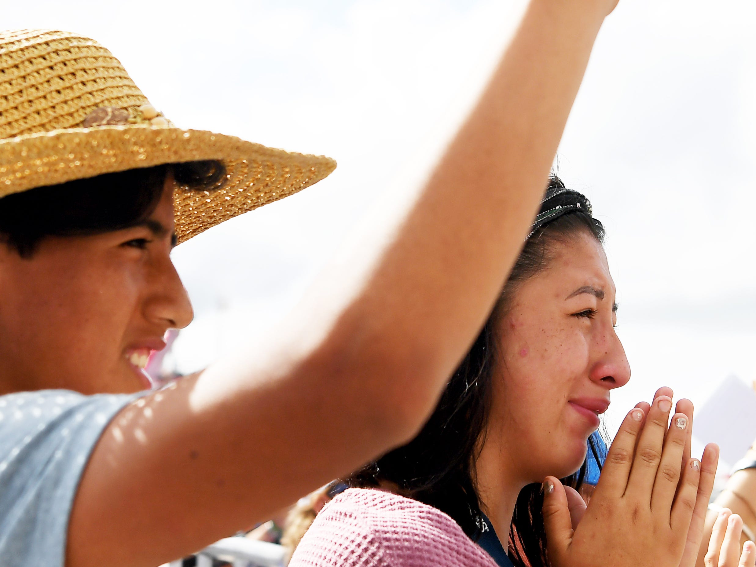 Mateo Mendoza, 15, waves to his father as his sister, Francis, 17, cries following Julio Mendoza's dressage competition at the World Equestrian Games in Tryon Sept. 13, 2018.