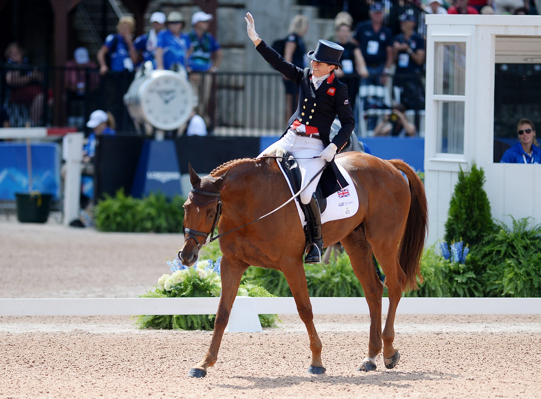 Great Britain's Piggy French waves to the cheering crowd as she rides Quarrycrest Echo following the dressage portion of the eventing competition at the World Equestrian Games in Tryon Sept. 13, 2018.