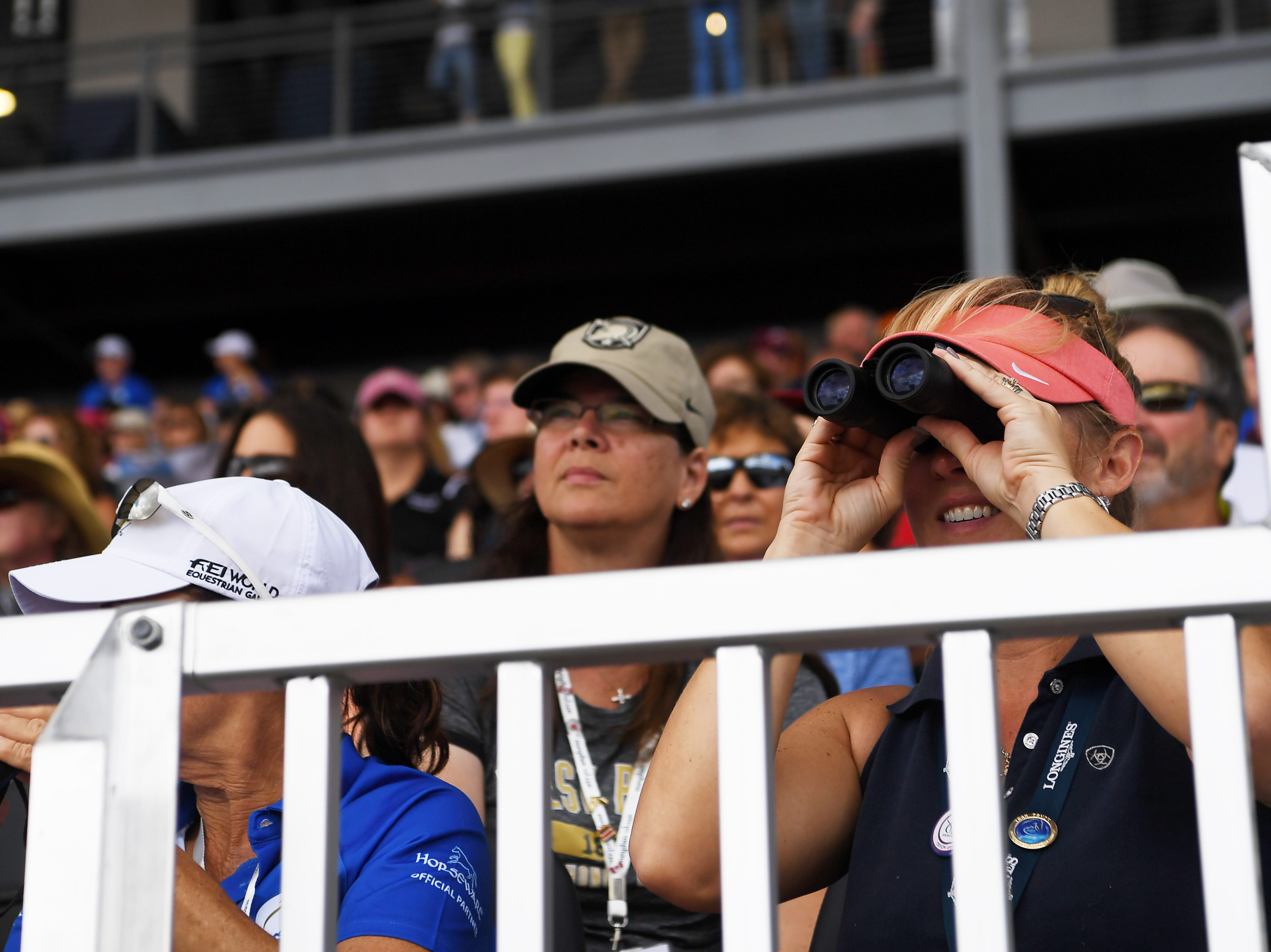 Spectators watch the dressage competition at the World Equestrian Games in Tryon Sept. 13, 2018.
