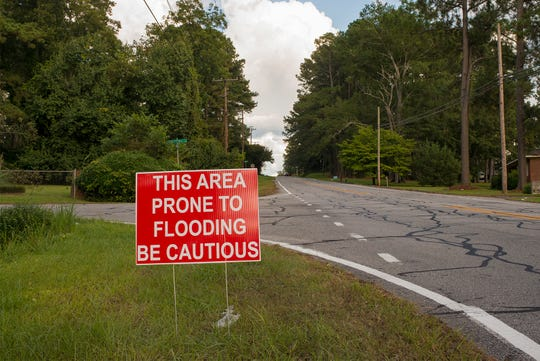 The sign says it all: Much of Kinston sits adjacent to the Neuse River, which in heavy rain bursts its banks and, in the past, has devastated the community.