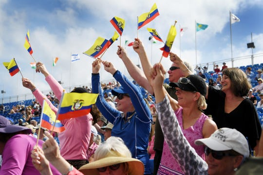 Family and friends of Julio Mendoza, of Columbus, NC, wave the Ecuadorian flag following Mendoza's dressage competition at the World Equestrian Games in Tryon Sept. 13, 2018.