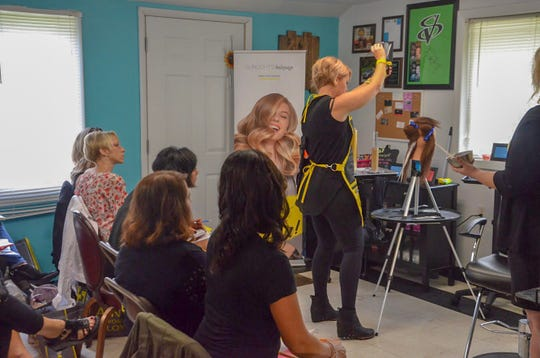 Lacie Wehrle explains balayage techniques to a class of stylists at Jen-Nay's Hair Studio on Monday, Sept. 10, 2018.