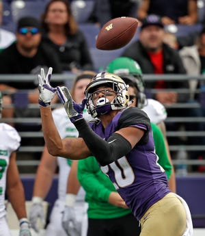 Washington receiver Ty Jones catches a pass during last week's game against North Dakota. On Saturday, Jones will return to his home state of Utah for the Huskies' game against the Utes.
