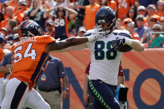 Will Dissly, a Seahawks rookie from the University of Washington, was better known for his blocking skills coming out of college. But he caught three passes for 105 yards and a touchdown in his first NFL game, Sunday's loss in Denver.