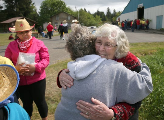 Coleta Corey gets a hug during a previous Corey's Day on the Farm. She and her husband, Nick, started the event after hosting the special-needs classmates of their son, Danny, at their farm off Luoto Road in 1968.