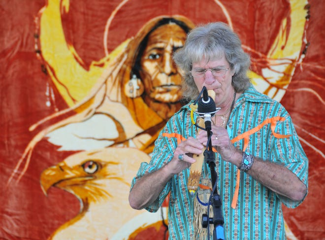 Dock Green Silverhawk plays the flute during a previous Native Rhythms Festival at Wickham Park. The 2018 festival is scheduled for Nov. 9-11. The event was awarded a $10,210 Cultural Marketing Program grant.