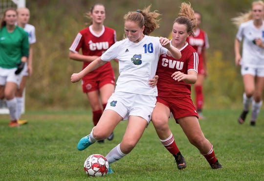 Colchester's Ava Hayes edges out Champlain Valley's Olivia Morton for possession during Wednesday's high school girls soccer game in Hinesburg on Sept. 12, 2018.