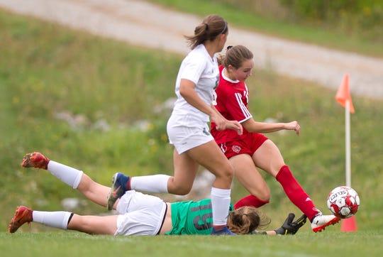 Champlain Valley's Josie Pecor slips a cross beyond the fingertips of Colchester goalie Olivia Moore during Wednesday's high school girls soccer game in Hinesburg on Sept. 12, 2018.