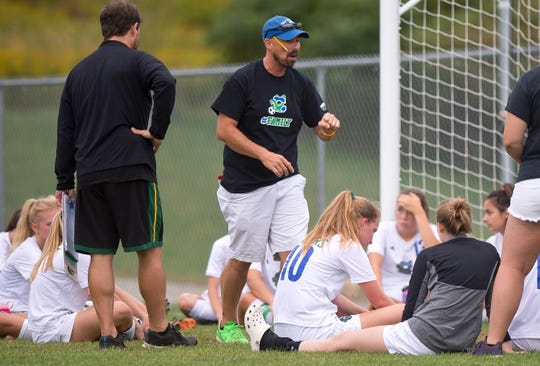 Colchester coach Jeff Paul talks to his team at halftime during Wednesday's high school girls soccer game in Hinesburg on Sept. 12, 2018.