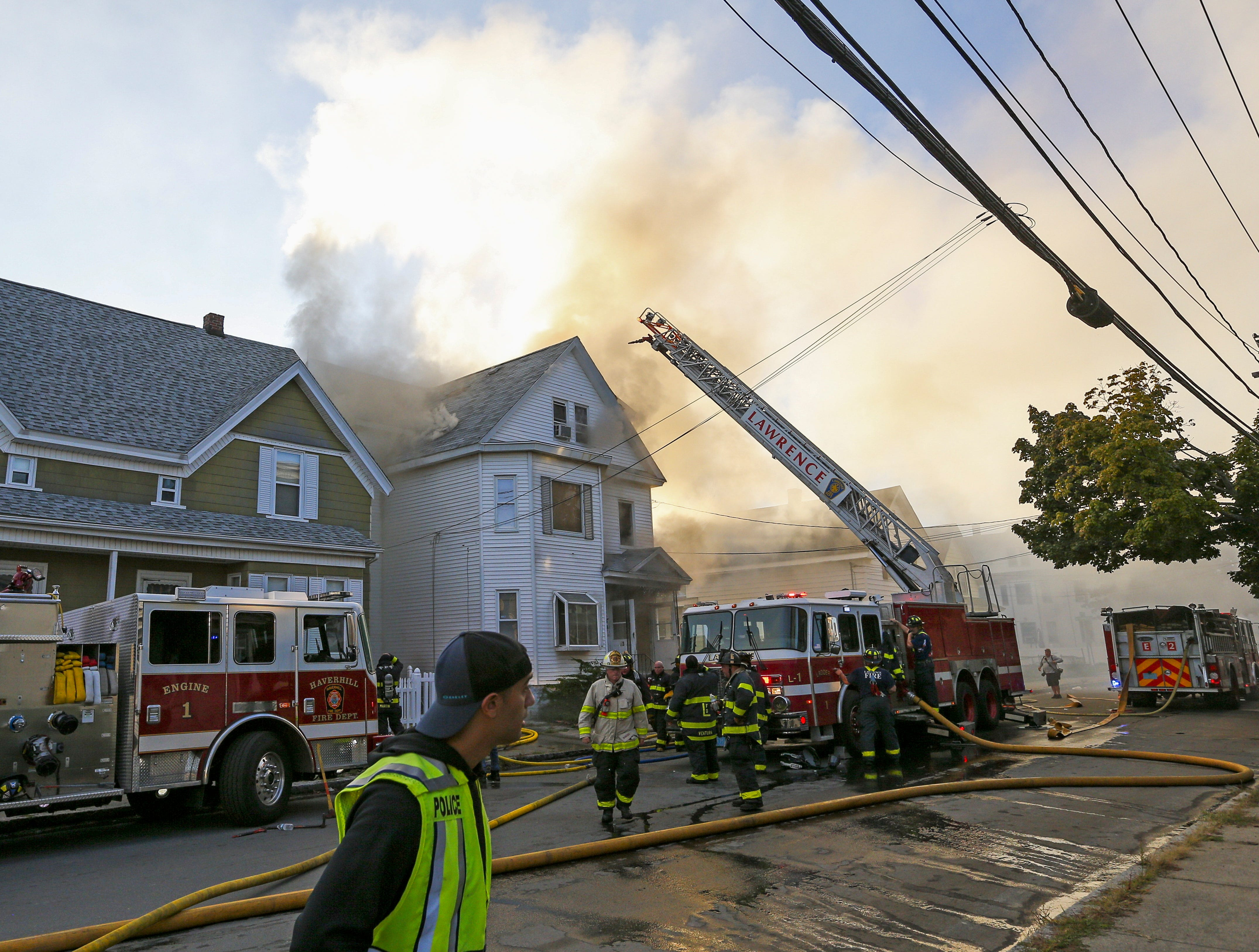 epa07018414 Firefighters battle a fire in a house in Lawrence, Massachusetts, USA, 13 September 2018. A series of reported gas explosions in towns north of Boston Massachusetts set homes ablaze and forced mandatory evacuation for residents.  EPA-EFE/CJ GUNTHER