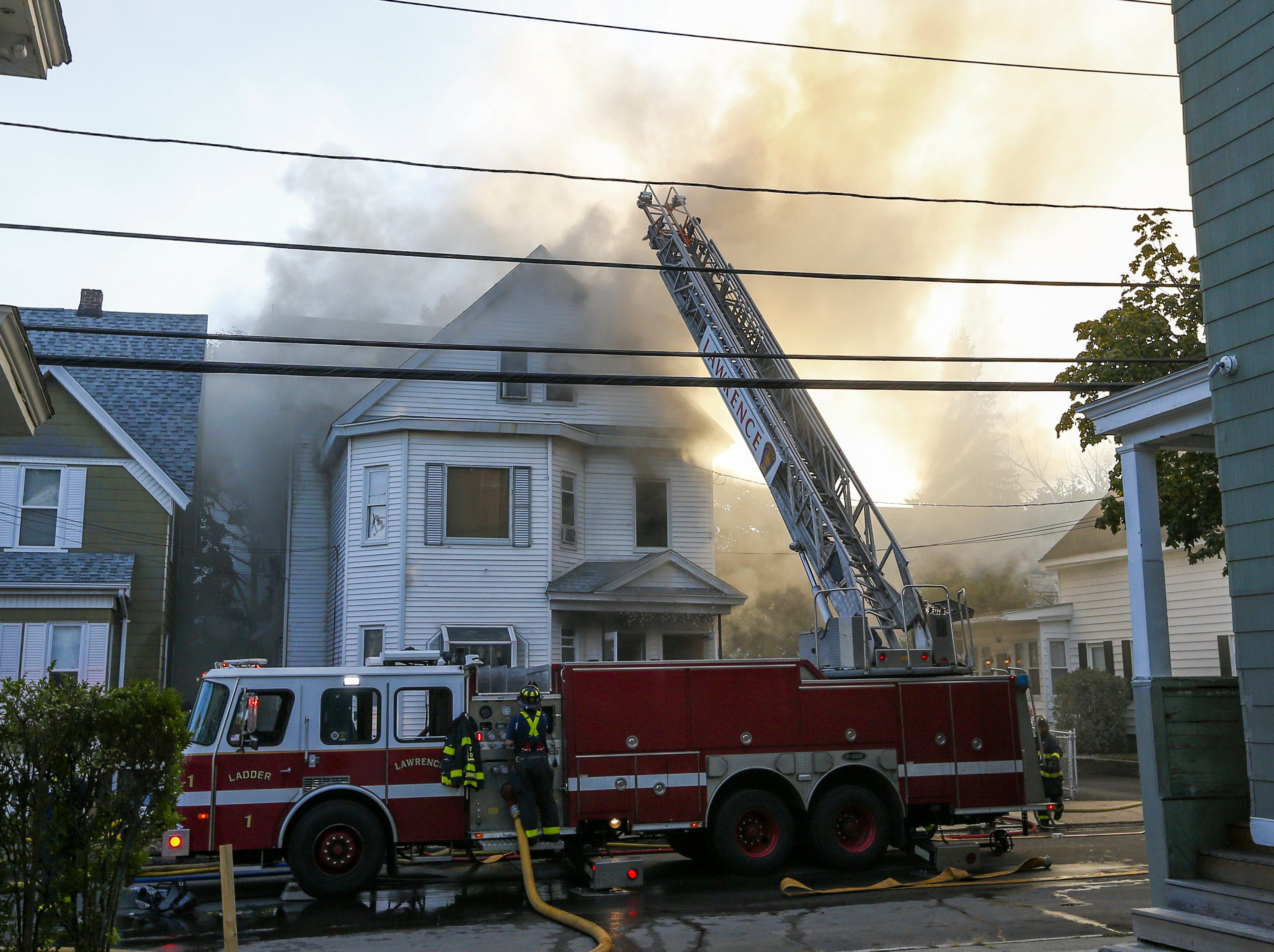 epa07018423 Firefighters battle blazes in a house in Lawrence, Massachusetts, USA, 13 September 2018. A series of reported gas explosions in towns north of Boston Massachusetts set at least 39 homes ablaze and forced mandatory evacuation for residents.