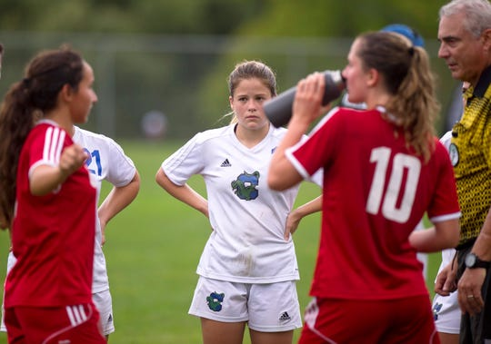 Colchester's Madison Finelli listens during the captains' meeting with officials before the start of overtime during Wednesday's high school girls soccer game in Hinesburg on Sept. 12, 2018.
