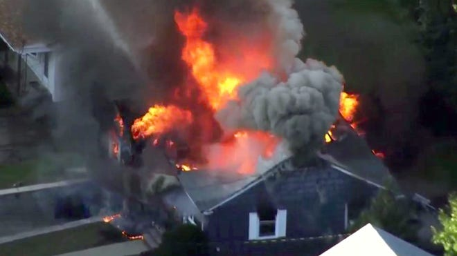 In this image take from video provided by WCVB in Boston, flames consume a home in Lawrence, Mass, a suburb of Boston, Thursday. Emergency crews responded to what they believe is a series of gas explosions that have damaged homes across three communities north of Boston. (WCVB via AP)
