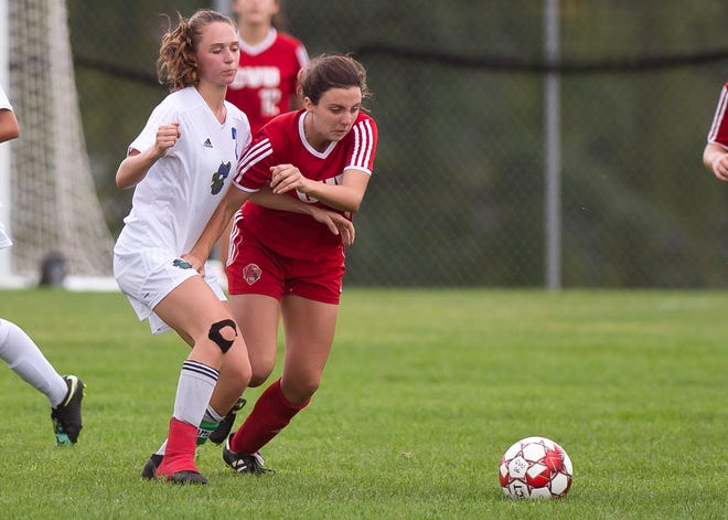 Colchester's Ani McMannon, left, and Champlain Valley's Lilly Cazayoux fight for position on the ball during Wednesday's high school girls soccer game in Hinesburg on Sept. 12, 2018.
