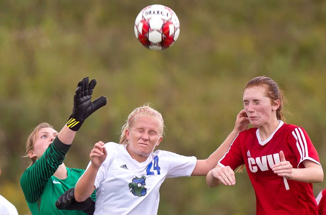 Champlain Valley's Catherine Gilwee, right, tries to head a free kick above Colchester's Jessica Nelson, center, and Olivia Moore during Wednesday's high school girls soccer game in Hinesburg on Sept. 12, 2018.