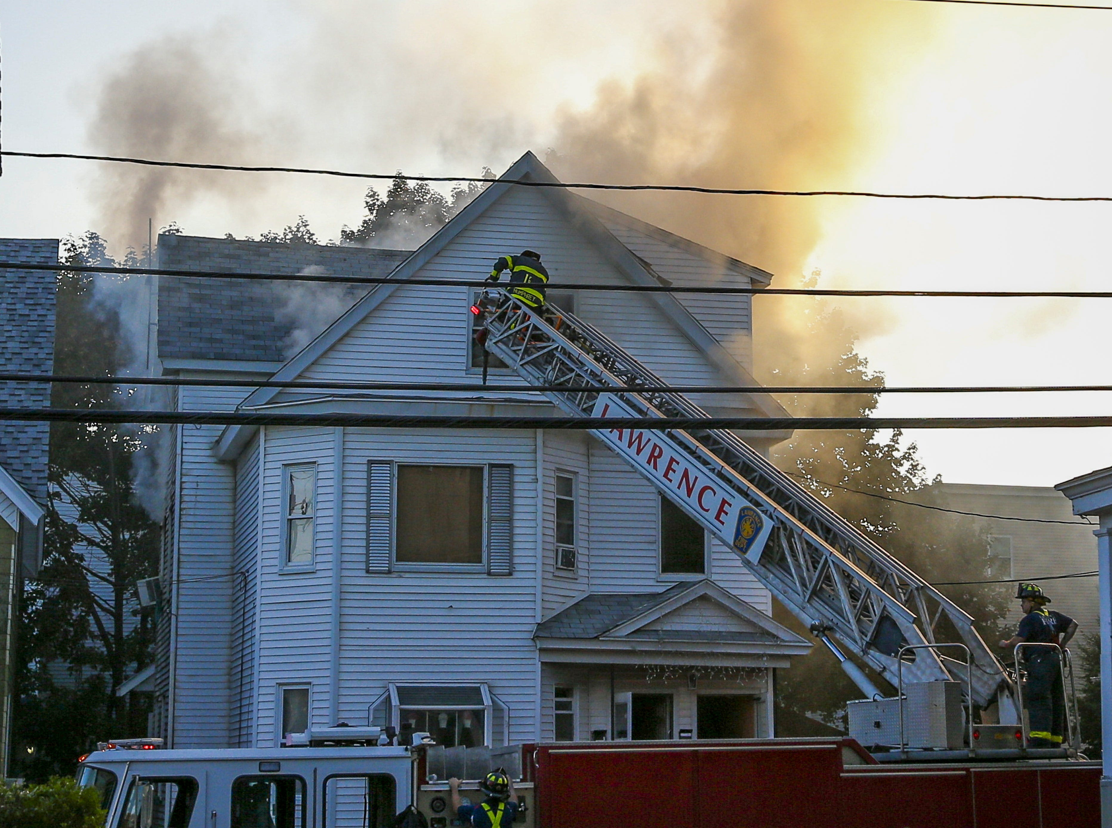 epa07018424 Firefighters battle blazes in a house in Lawrence, Massachusetts, USA, 13 September 2018. A series of reported gas explosions in towns north of Boston Massachusetts set at least 39 homes ablaze and forced mandatory evacuation for residents.