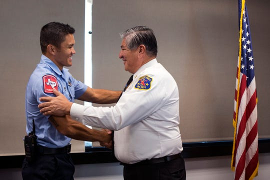Corpus Christi firefighter Josh Brunemeier (left) is congratulated by Corpus Christi Fire Chief Robert Rocha as he is honored as Firefighter of the Year by the Kiwanis Club of Corpus Christi during a luncheon at the Congressman Solomon P. Ortiz International Center on Thursday, Sept. 13, 2018.