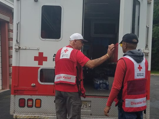 American Red Cross New Jersey Region disaster workers Vincent Giammusso (left) of Gloucester County and Steve Chico of Bergen County prepare an emergency response vehicle as they depart for Hurricane Florence relief efforts in North Carolina.