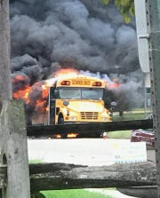 A school bus quickly went up in flames in front of the Piston Diner in Westville.